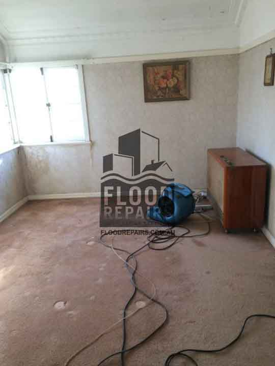 damaged room before Flood Restoration & Repairs repairing and cleaning