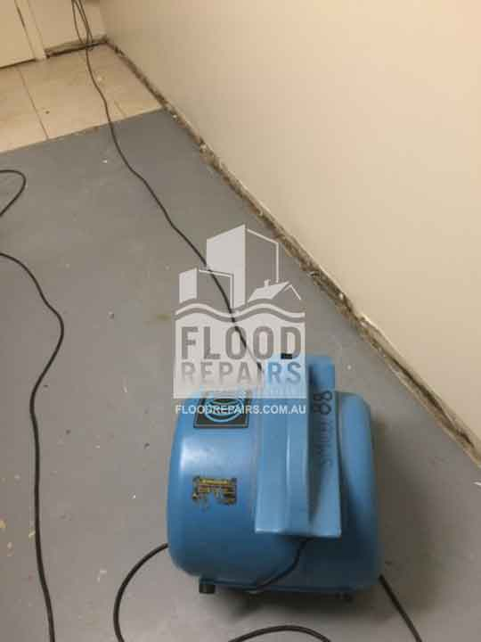 wall and floor before Flood Restoration & Repairs cleaning and repairing
