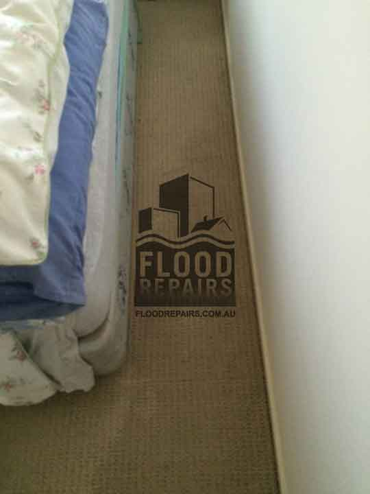 wet bedroom carpet before drying and cleaning